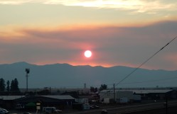The sun setting over the mountains west of Missoula, seen through the smoke from the Lolo Pass fire.The sun setting over the mountains west of Missoula, seen through the smoke from the Lolo Pass fire.