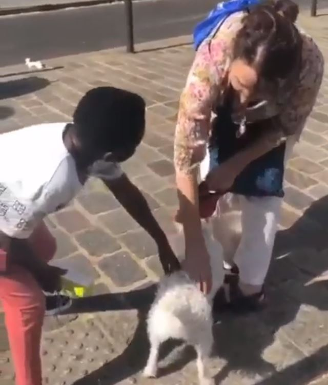 My dog's name is Shatta- Yaw Dabo tells a white woman as he chills in France
