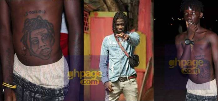 Fan tattoo Stonebwoy's face on his stomach