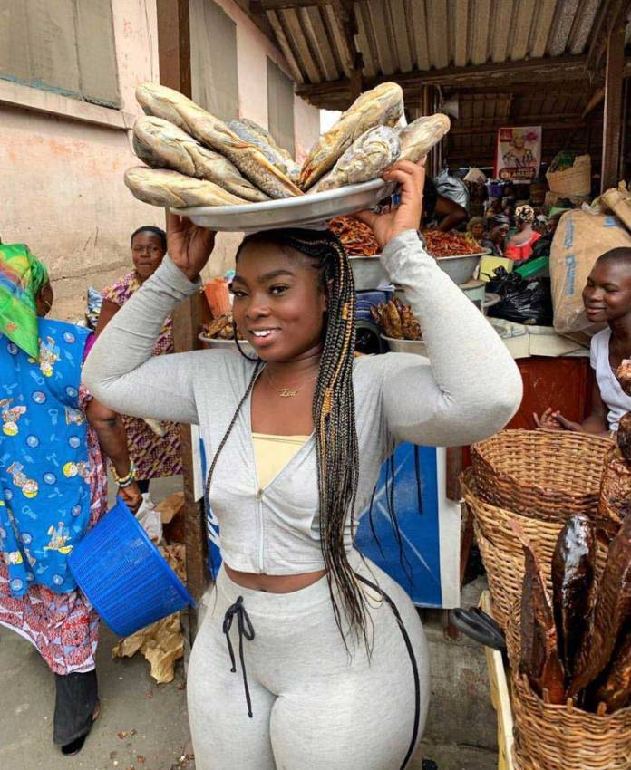 Zeebee selling dry fish at the Adabraka market in Accra