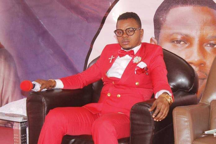 Angel Obinim 7 - Angel Obinim & his junior pastors lashes a Church member for failing to stake 2 Sure