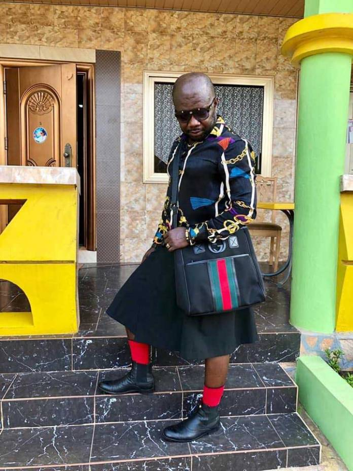 Osebo wearing skirt shirt 2 - Photos of Nana Aba's baby daddy Osebo stylishly roaming town wearing skirt & shirt again go viral