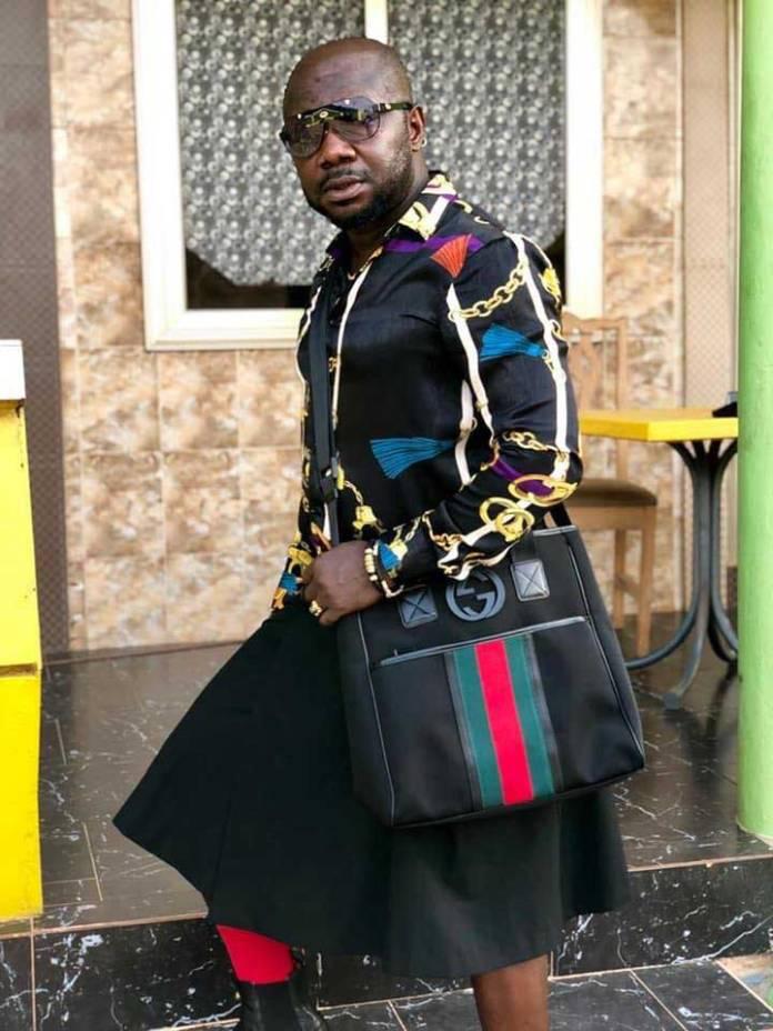 Osebo wearing skirt shirt 3 - Photos of Nana Aba's baby daddy Osebo stylishly roaming town wearing skirt & shirt again go viral