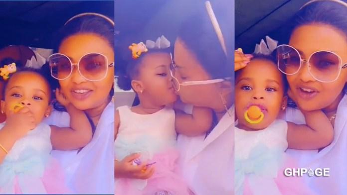 Nana Ama Mcbrown kisses Baby Maxin again in new video