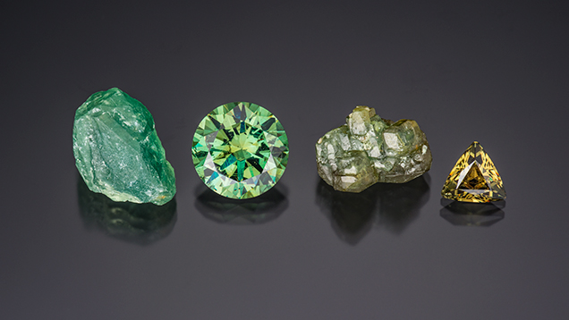 This selection of andradite garnet from Namibia's Green Dragon mine includes an 11.63 ct demantoid round brilliant, an unusually large stone for this source. Photo by Robert Weldon/GIA, courtesy of Green Dragon mine.