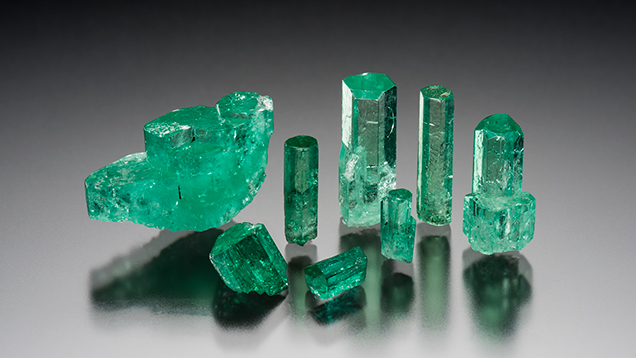 A sampling of the rough emeralds obtained for GIA's country-of-origin reference collection. These samples, ranging from 0.445 to 6.397 ct, came from Coscuez. Photo by Kevin Schumacher.