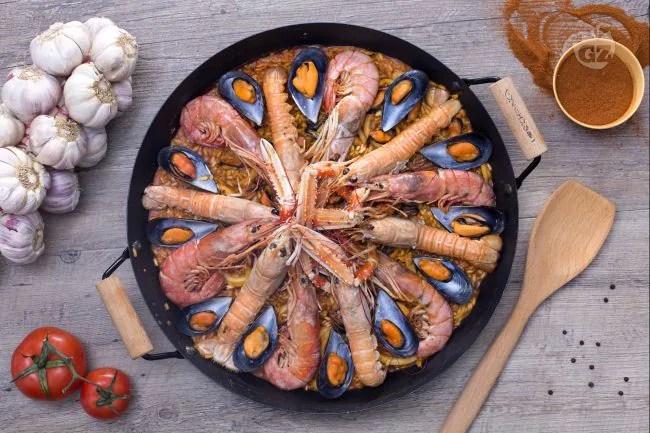 Ricetta Paella de marisco  La Ricetta di GialloZafferano