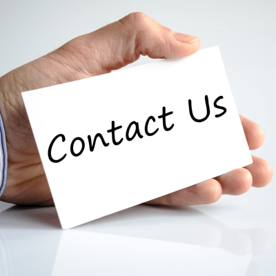 hand holding a card with Contact Us written on it