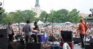 band in front of festival crowd viewed from behind