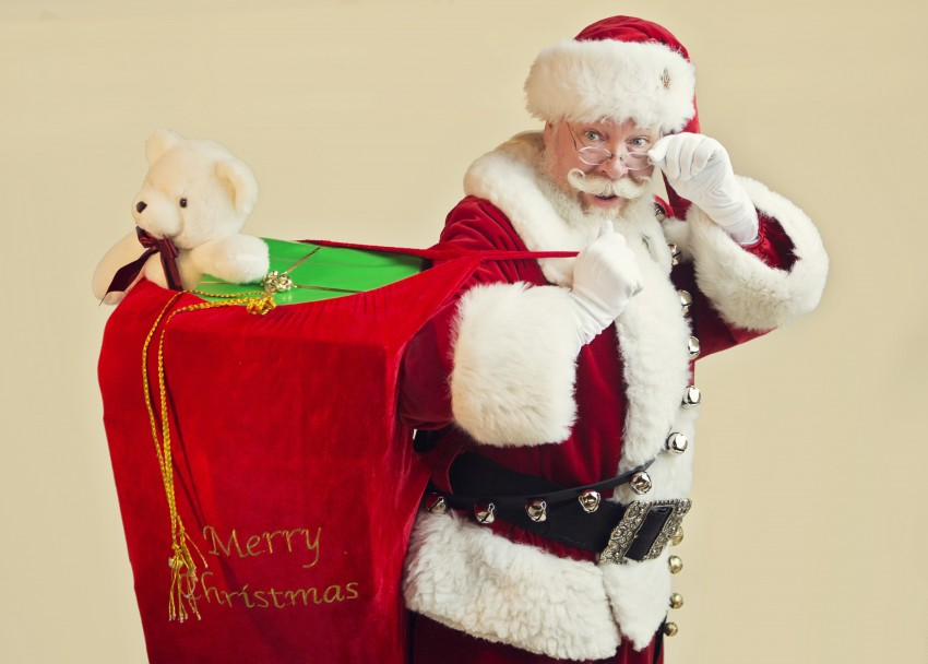 Santa carries a sack of gifts to visit families and homes.