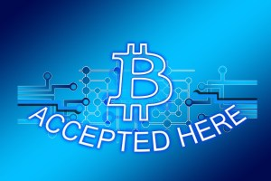 """Expect to see more """"bitcoin accepted"""" buttons all the time."""