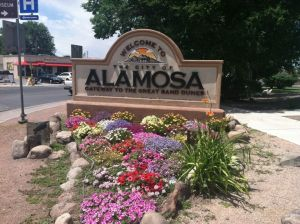 Some of Alamosa's gardeners planted a greeting at the entry to the town.