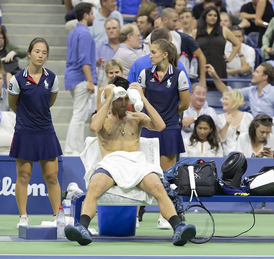 New York, NY - September 5, 2018: Novak Djokovic of Serbia cools off using ice, towel & portable fan during US Open 2018 quarterfinal match against John Millman of Australia at USTA Billie Jean King National Tennis CenPhoto: Lev Radin/Gildshire)