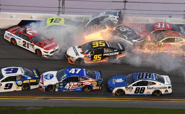 Major pileup with just ten laps to go at the Daytona 500, later won by Denny Hamlin.
