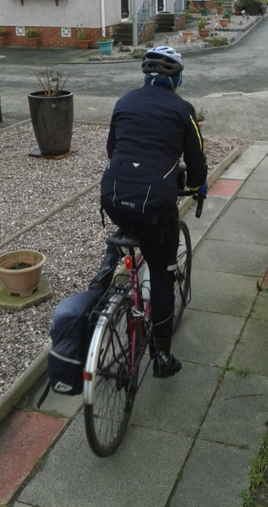 Hardy cyclist leaves for work