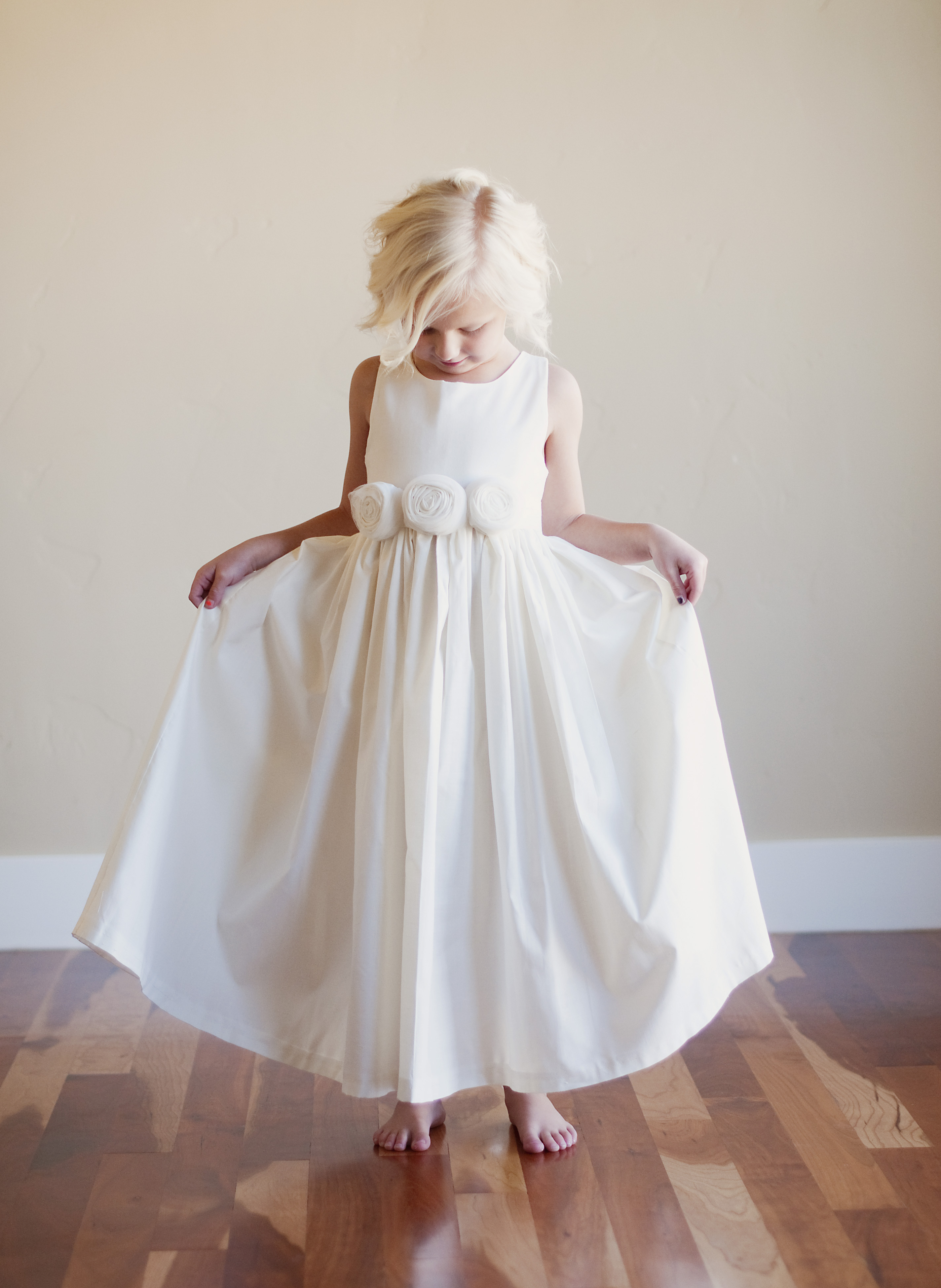 An ivory flower girl dress sfor beach wedding or rustic wedding  Gilly Gray Bespoke Wedding and