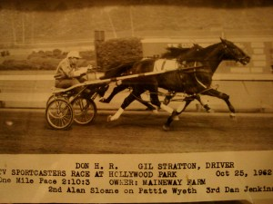 Gil is the winning driver of Don H.R. (owned by Maineway Farm) at the one mile 1962 TV Sportscasters harness race at Hollywood Park.