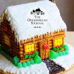 log cabin gingerbread house made from a gingerbread house kit