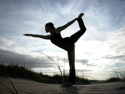 Ginger has successfully used yoga to treat a wide range of women's health issues, including recovering from her own three pregnancies. Photo is Ginger in dancer's pose ©2004