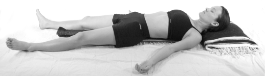Ginger pictured in Supine Over Accordion Fold Restorative Yoga  ©2014 Ginger Garner. All rights reserved.