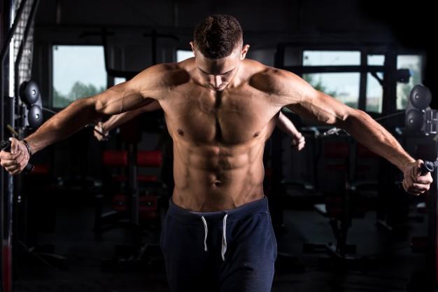 Young bodybuilder using fitness equipment 1163 3568