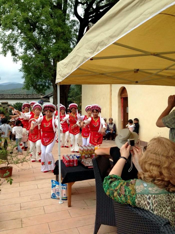 Traditional Bai village dancers perform at Pear Orchard Temple - by Chris Barclay Shaxi Yunnan China