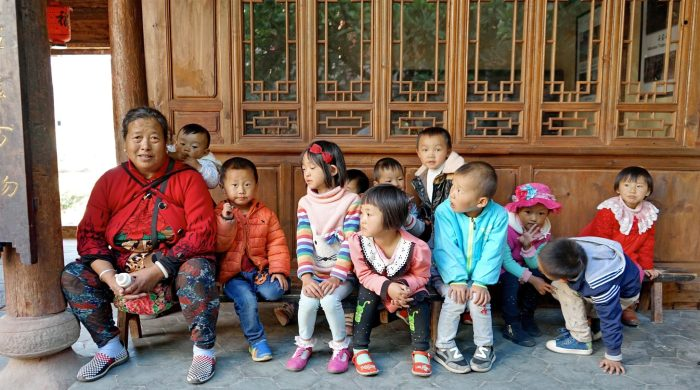Grandma and village children - Pear Orchard Temple - Shaxi Yunnan China