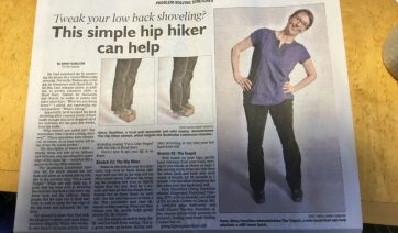 "Photo of newspaper health section with the headline ""Tweak your low back shoveling? This simple hip hiker can help."" One large photo shows a woman standing with her hands on her hips, side bending. Two other photos show standing on one foot and lifting the other foot higher, then dropping it down lower."
