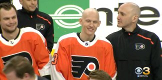 Flyers' forward Oskar Lindblom smiles for the team picture