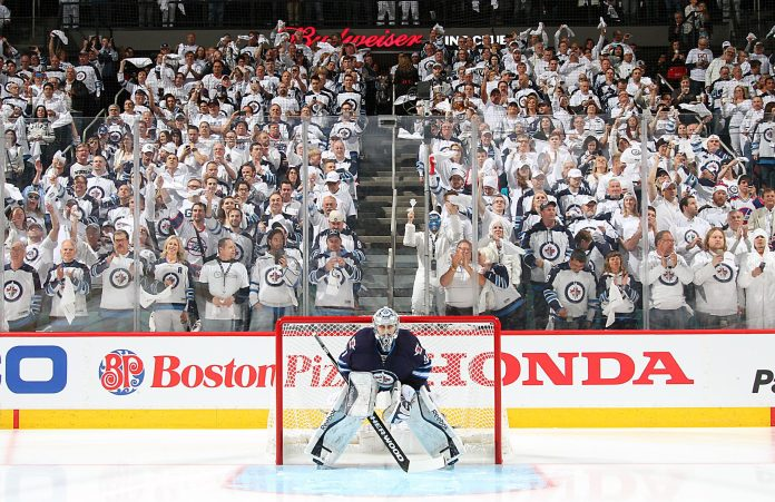 Winnipeg Jets' goalie Connor Hellebuyck in front of the Winnipeg whiteout