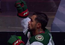 Matt Dumba raises first during National Anthems