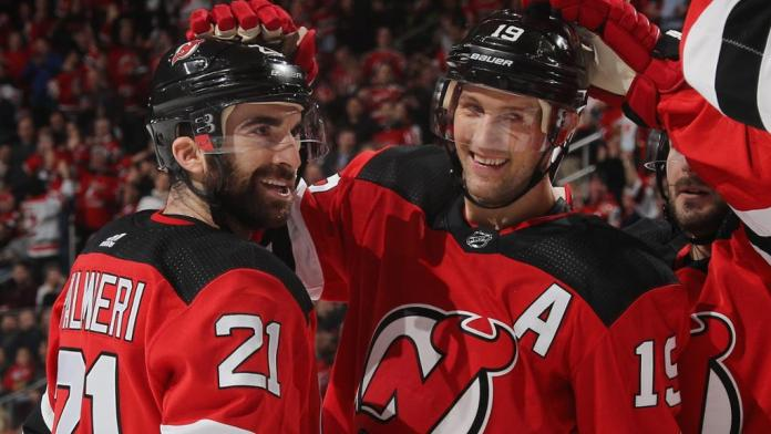 Travis Zajac and Kyle Palmieri celebrate a goal
