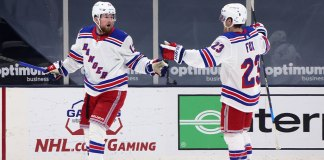 New York Rangers' Alexis Lafreniere and Adam Fox celebrate a goal