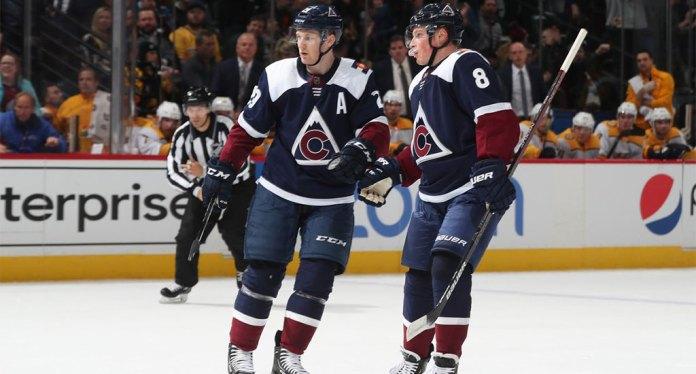Nathan MacKinnon and Cale Makar celebrate a goal