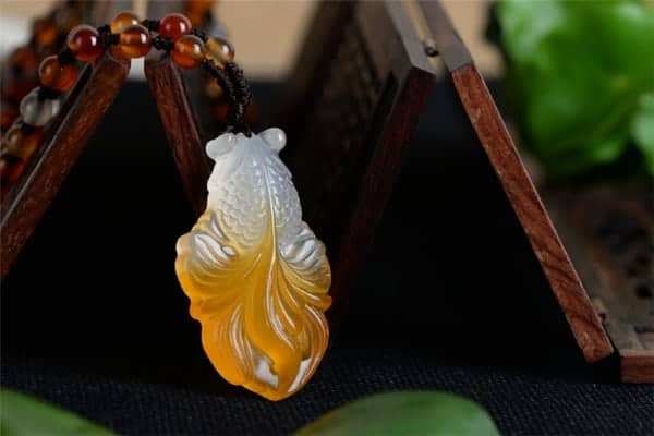 jade fish pendant meaning benefits of wearing fish pendant
