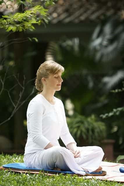 zen koi woman meditating at zen garden