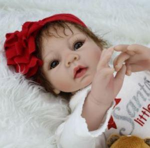 bambola reborn con fiocco rosso