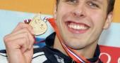 Norway's Alexander Dale Oen celebrates w