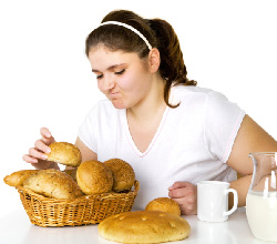 Photo of a teenage girl deciding what to eat.
