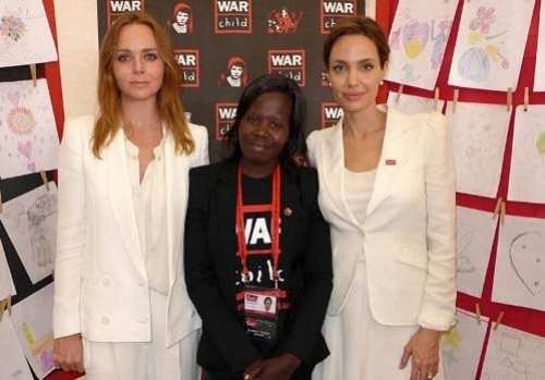 Stella McCartney and Angelina Jolie with Polline. Picture War Child UK