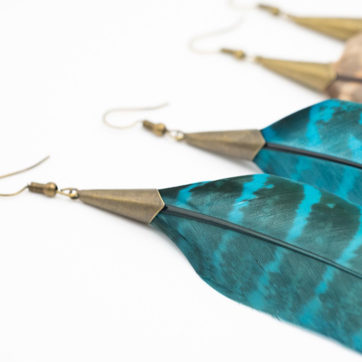 ORB-043 blauwe veer oorbellen lang en groot kopen