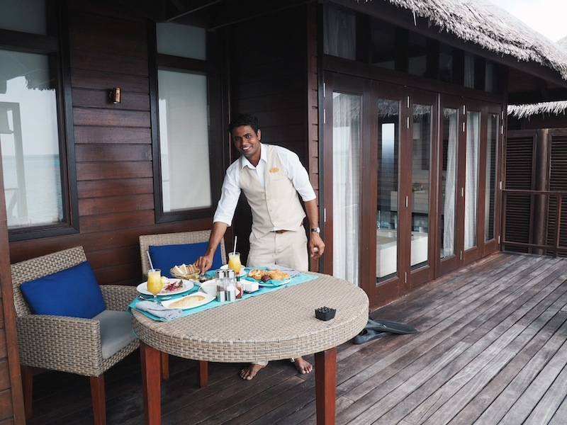 Smiling butler Mohan sets up our in-villa breakfast