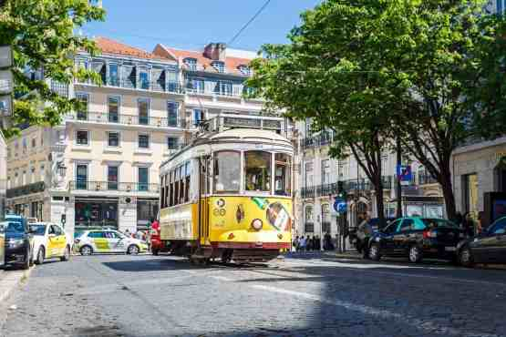 The iconic, yellow, tram 28 that runs through Lisbon, Portugal.