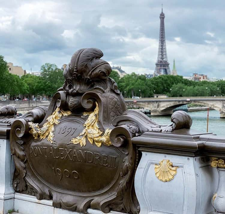 Visit Pont Alexandre III bridge and enjoy this amazing piece of historic architecture with a stunning view of the Eiffel Tower in the background.