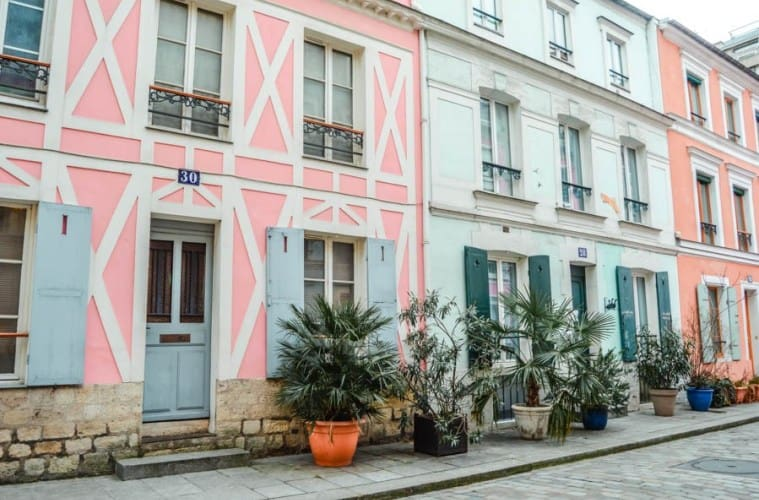 Some of the vibrant, pastel-hued homes that you'll find along Rue Crémieux.