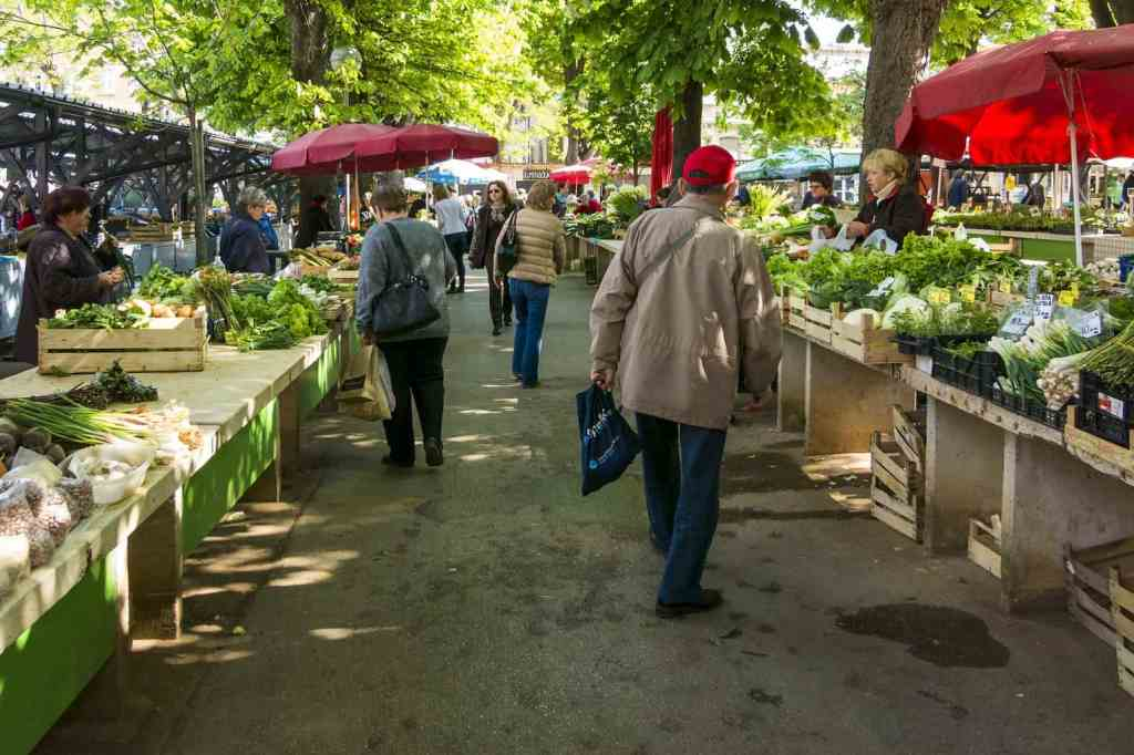 Solo travel Paris like the locals and enjoy one of the many amazing local farmer's markets.
