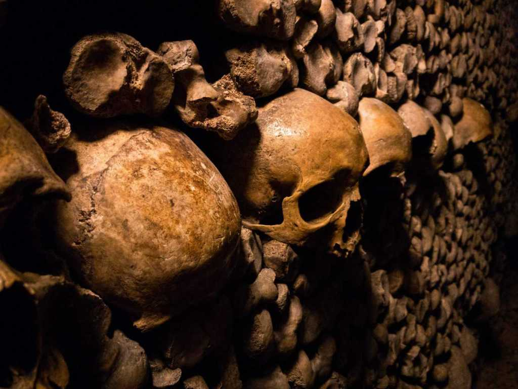 The macabre, skull-lined walls of the Parisian Catacombs.