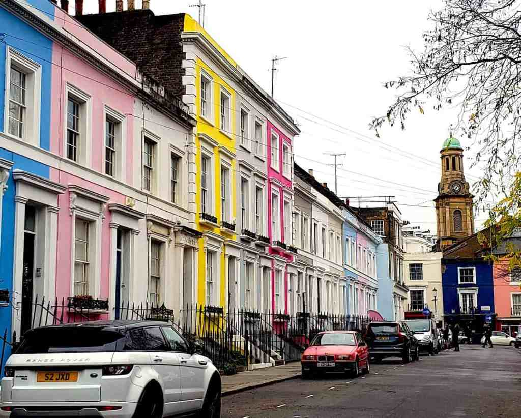 The colorful assortment of colorful houses that sit along Lancaster Street In Notting Hill.