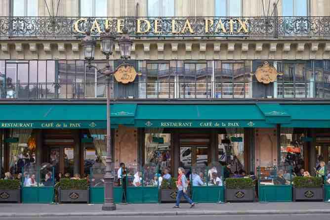 The chic, historic beauty of Cafe de la Paix in Paris.