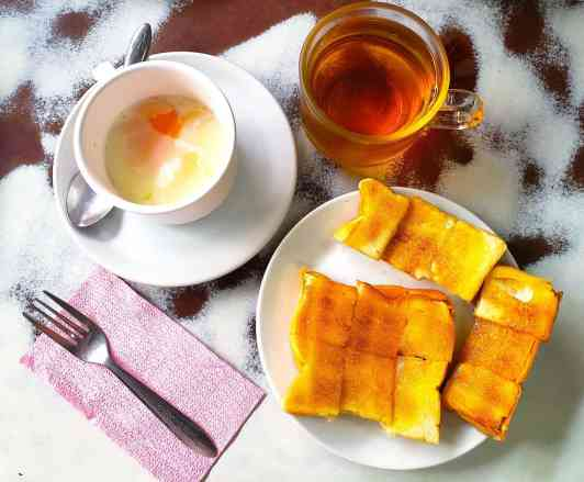 My breakfast at On Luk Yun consisted of soft boiled egg, toast with butter, and tea. just use the fork to dip the toast into the egg. And I promise it's way more delicious than it sounds.